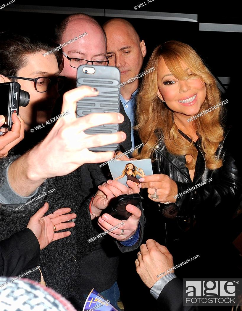 Stock Photo: Mariah Carey is swamped by fans as she arrives back at her hotel, having performed in Cardiff earlier in the evening Featuring: Mariah Carey Where: London.