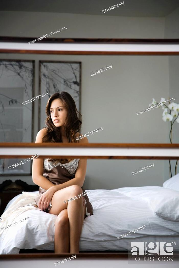 Stock Photo: A womans reflection in a mirror.
