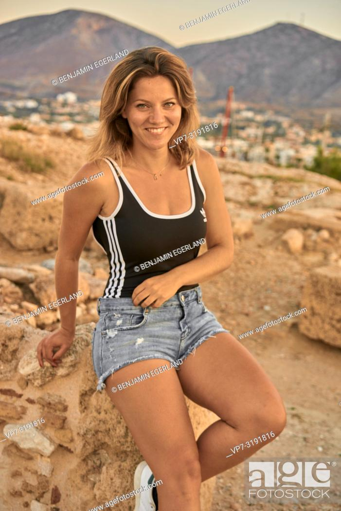 Imagen: portrait of a woman sit-in on ancient ruins, holiday, leisure, in Chersonissos, Crete, Greece.