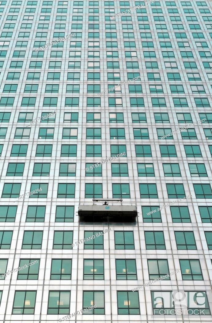 Stock Photo: A window cleaning cradle at one canada square, Canary Wharf, London, UK.