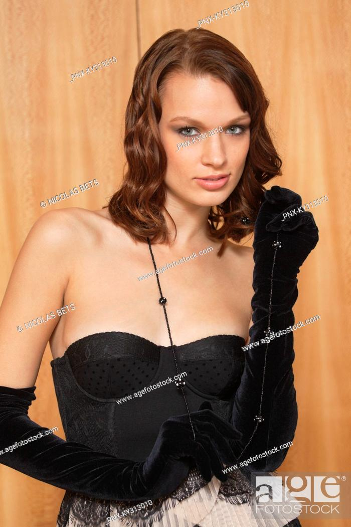 Stock Photo: Young woman wearing evening gown.