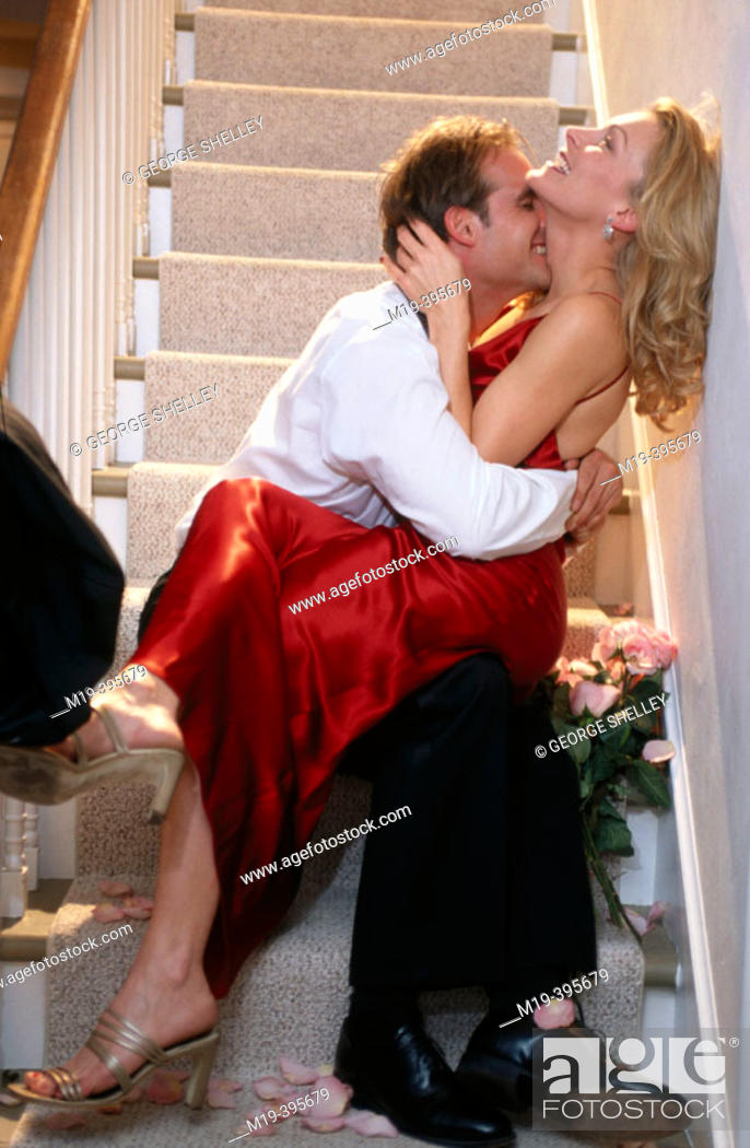 Stock Photo: romantic, well dressed couple on the stairs.