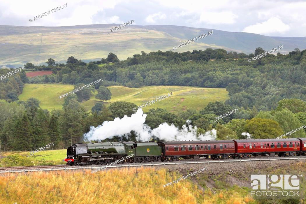 Stock Photo: Steam locomotive LMS Princess Coronation Class 46233 Duchess of Sutherland on the Settle to Carlisle Railway Line near Lazonby, Eden Valley, Cumbria, England.