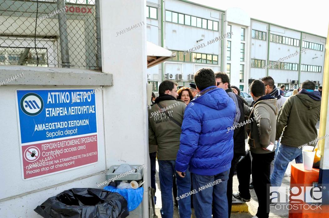 Employees of Attiko Metro (Athenian subway) stand at the