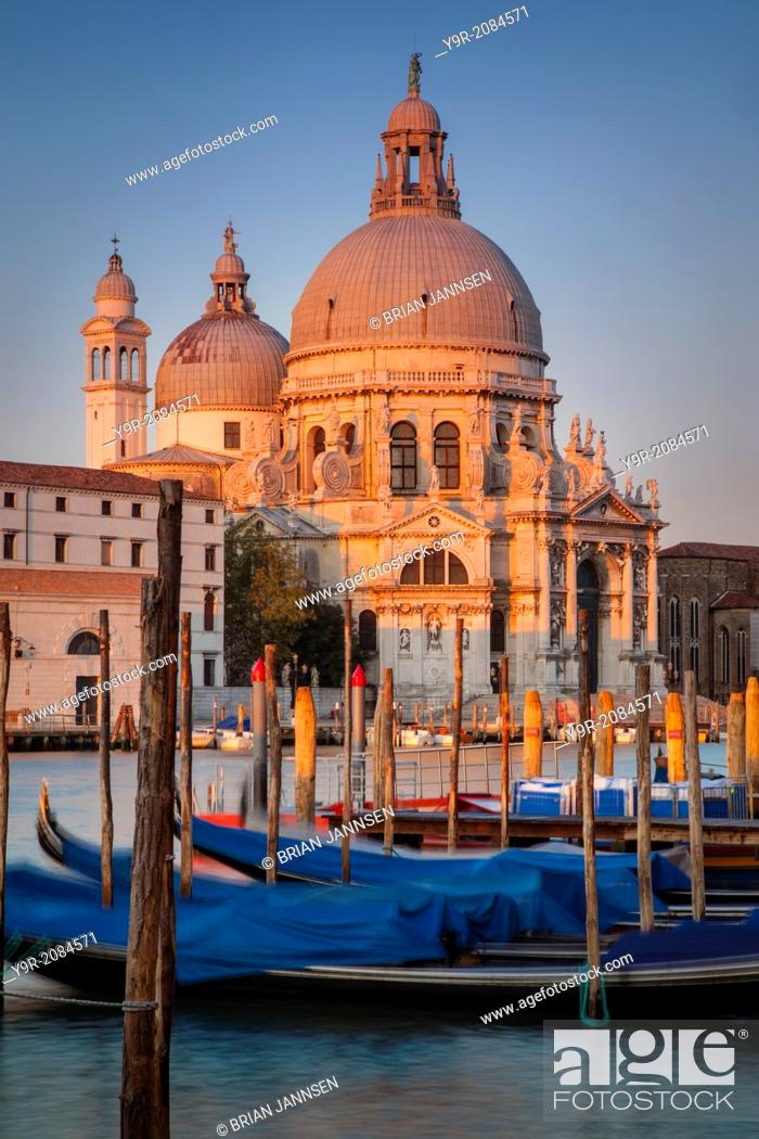 Stock Photo: First light of sunrise against the Santa Maria della Salute Church, Venice Italy.