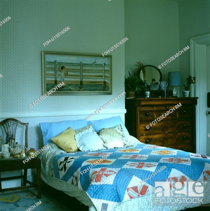 Stock Photo Blue Patterned Patchwork Quilt On Bed In Traditional Bedroom