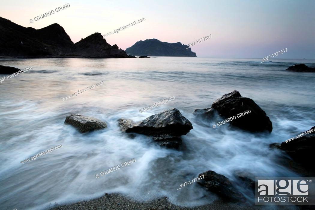 Stock Photo: View from west to east at dawn the 'head of Cope' from a beach near the Barranco de la Mar, Cabo Cope, Murcia, Spain.