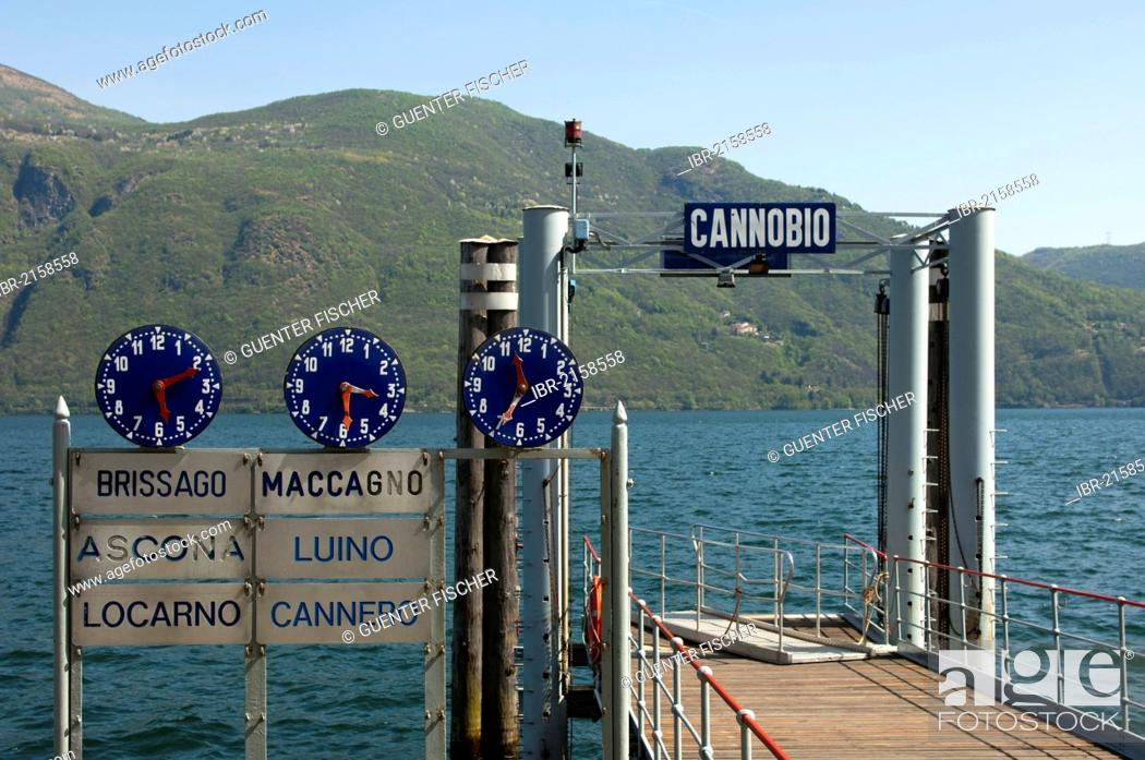 Stock Photo: Clocks displaying departure times at the Cannobio jetty on Lake Maggiore, Piedmont, Italy, Europe.