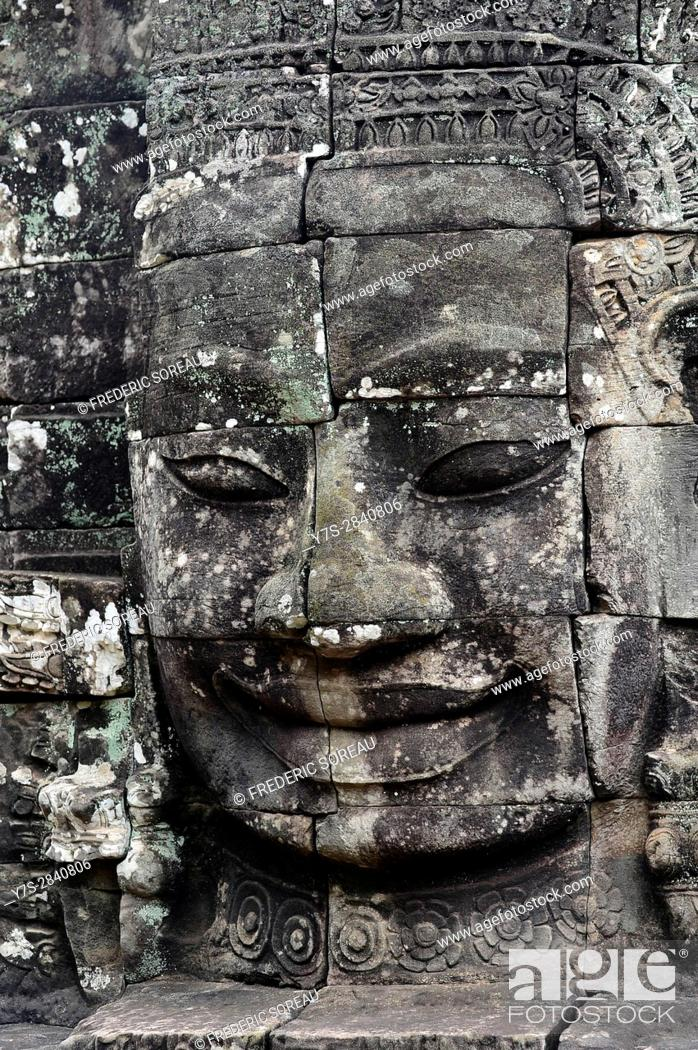 Stock Photo: Carved stone head at Bayon temple, Angkor Wat, Cambodia, Indochina, Southeast Asia, Asia.