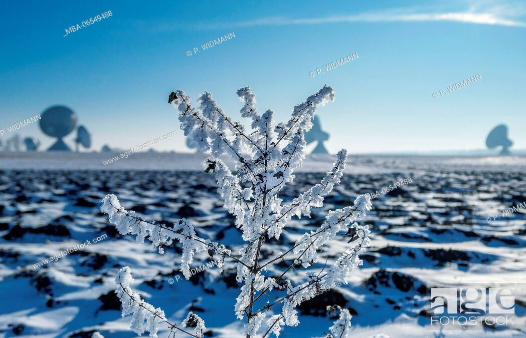 Stock Photo: Ploughed field in winter, covered with snow.
