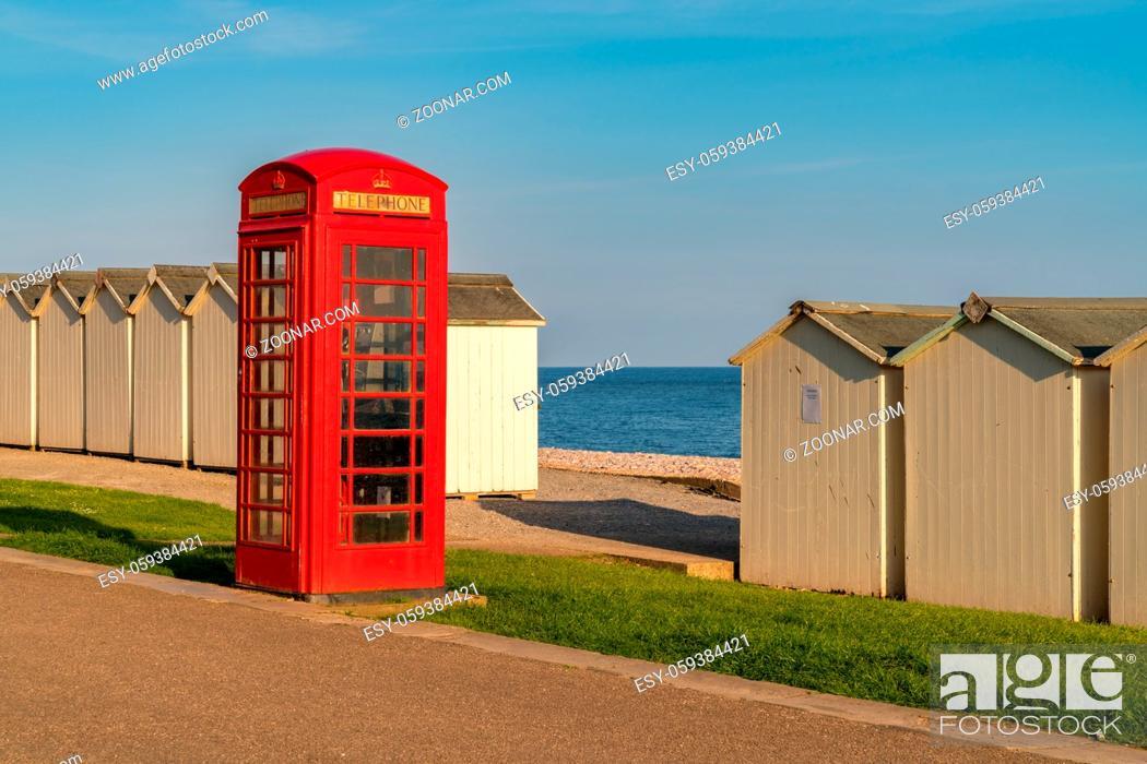 Stock Photo: Beach huts and phone booth near trhe pebble beach of Budleigh Salterton, Jurassic Coast, Devon, UK.