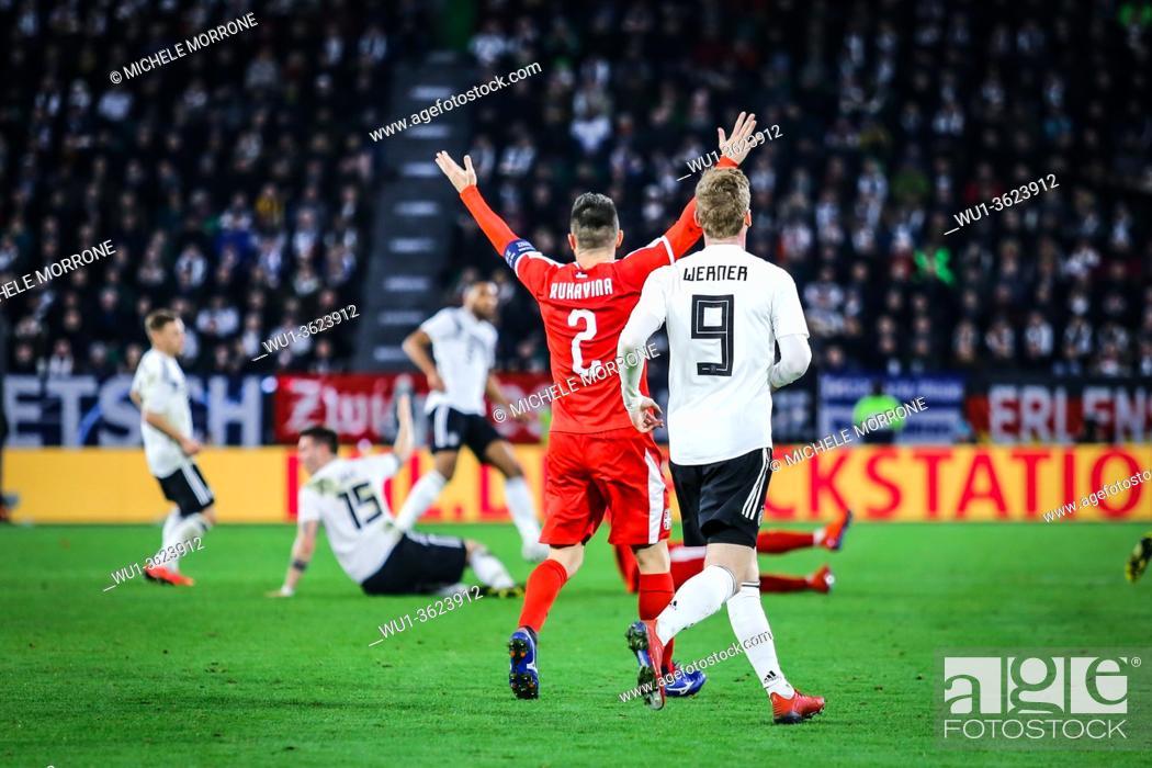 Stock Photo: Wolfsburg, Germany, March 20, 2019: Serbian national team captain Antonio Rukavina raises his arms during the international friendly game Germany vs Serbia at.