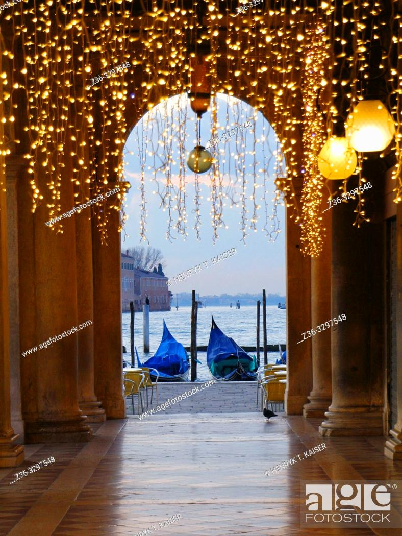 Stock Photo: St Mark s Square and gondolas before sunrise in carnaval decoration, Venice, Italy.