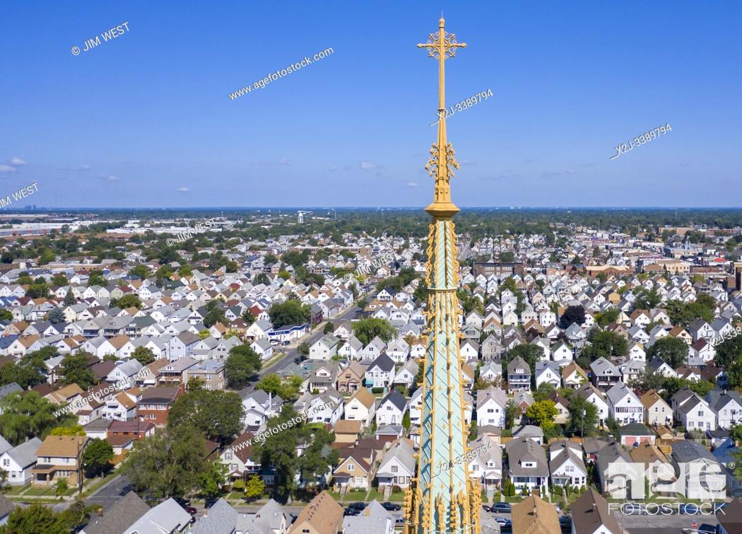 Stock Photo: Hamtramck, Michigan - The spire of St Florian Catholic Church rises nearly 200 feet above Hamtramck. The church was built in 1908 in the Polish Cathedral.