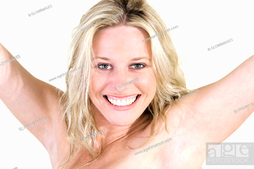Stock Photo: Portrait of a young woman smiling with her arms outstretched.
