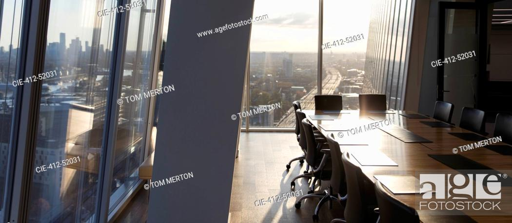 Stock Photo: Sunny empty modern conference room with city view.