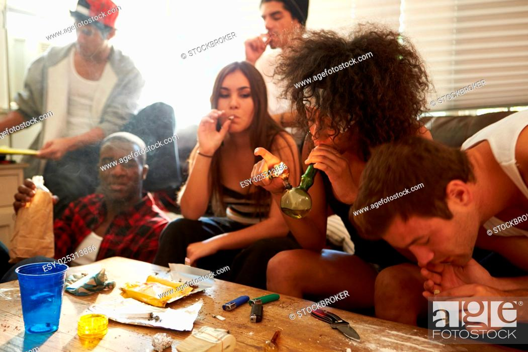 Stock Photo: Gang Of Young People Taking Drugs.