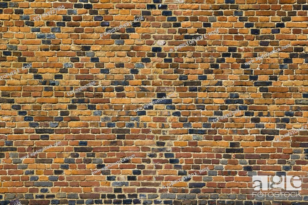 Stock Photo: Old patterned red brick wall full frame texture background.