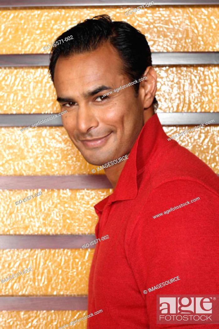Stock Photo: Smiling hispanic man.