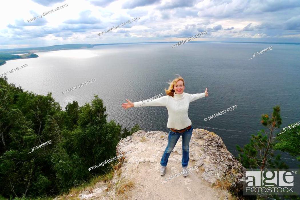 Stock Photo: 30 years old woman jumping in Molodeskiy Kurgan National Park in Toglyatty, Samara Region, Russian Federation, Russia.