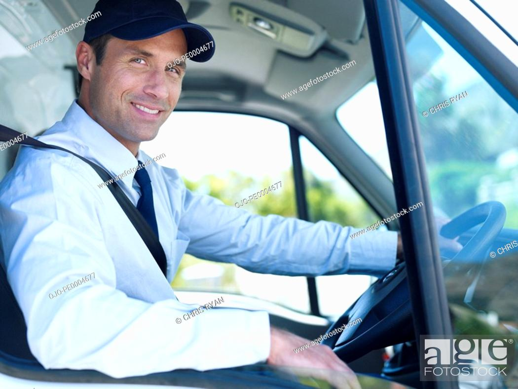 Stock Photo: Delivery person driving van.