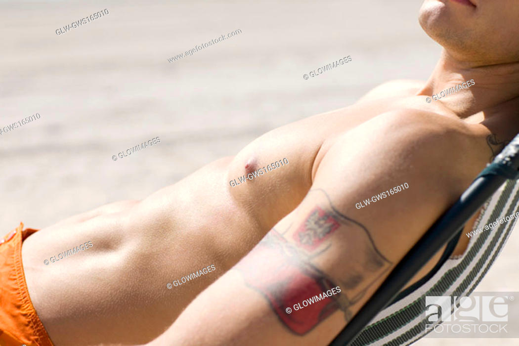 Stock Photo: Side profile of a man relaxing on the beach.