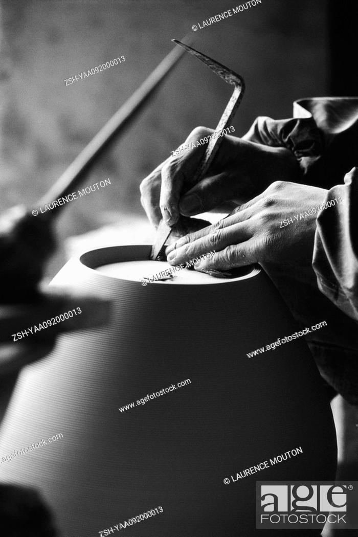 Stock Photo: Potter's hands shaping pottery.