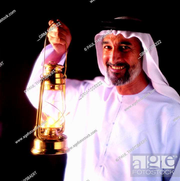 Stock Photo: Ramadan: Arab man holding lantern.