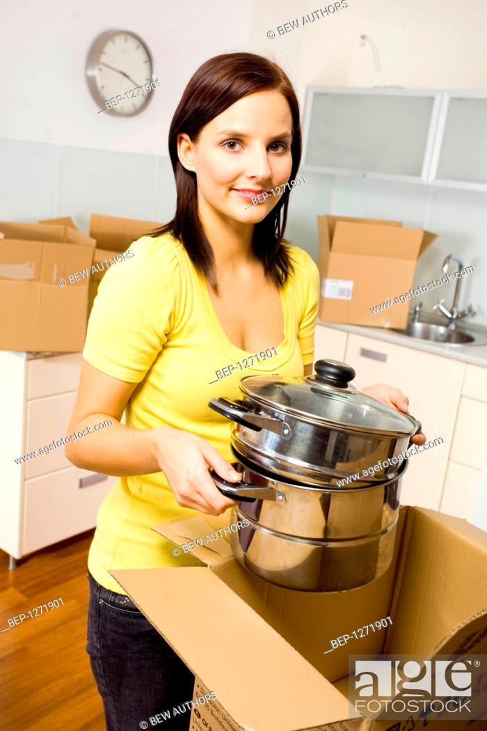 Woman Packing Equipment Needed In The Kitchen Stock Photo Picture And Rights Managed Image Pic Bep 1271901 Agefotostock