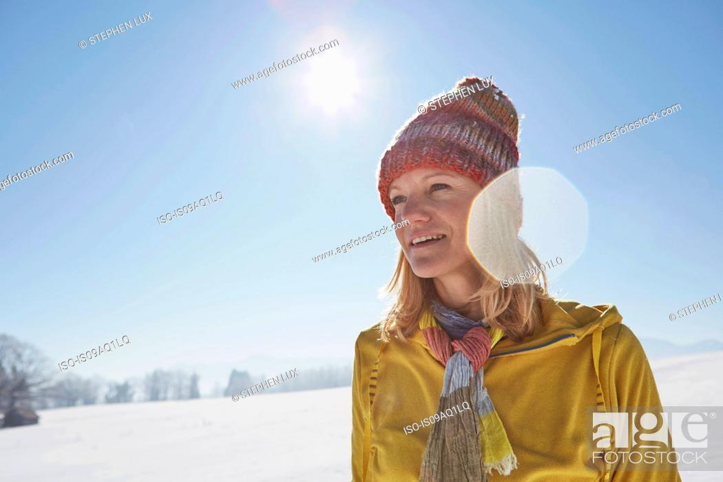 Stock Photo: Mature woman in snowy landscape.