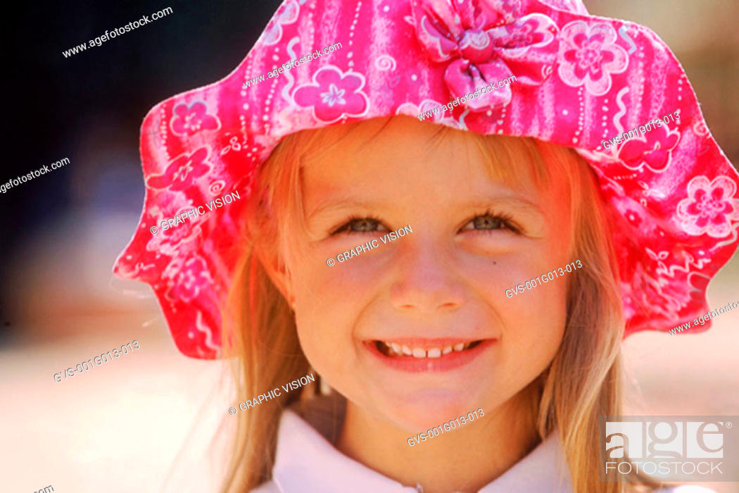 Stock Photo: Close-up of a girl wearing hat and smiling.