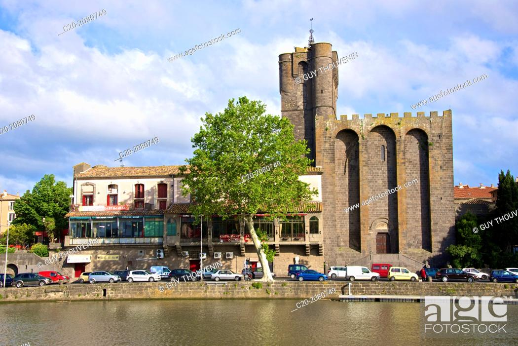 Stock Photo: Fortified Ancienne cathédrale St Etienne, 12thc., built in black lava, and river banks along Herault river, AGDE town, Haut Languedoc, 34 France.