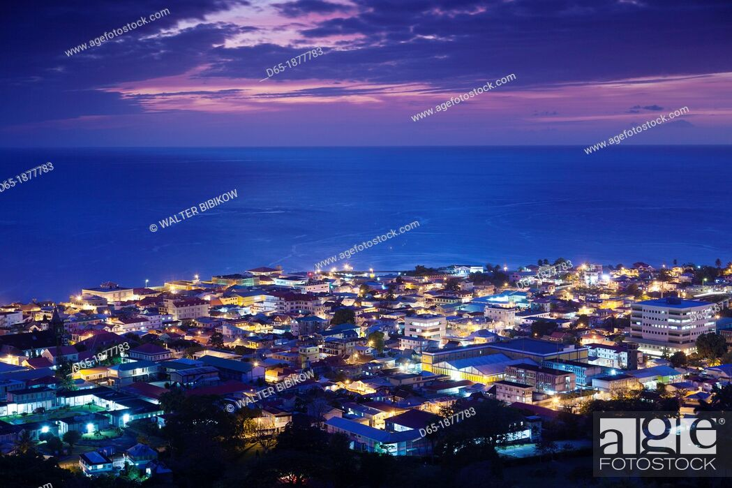 Stock Photo: Dominica, Roseau, elevated town view, dusk.