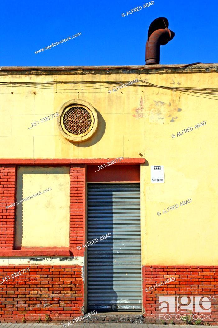 Stock Photo: metal gate of industrial building, industrial park, Sant Adrià de Besòs, Catalonia, Spain.