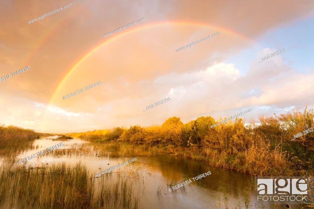 Stock Photo: Rainbow over PN s'Albufera, Majorca, Balearic Islands, Spain.