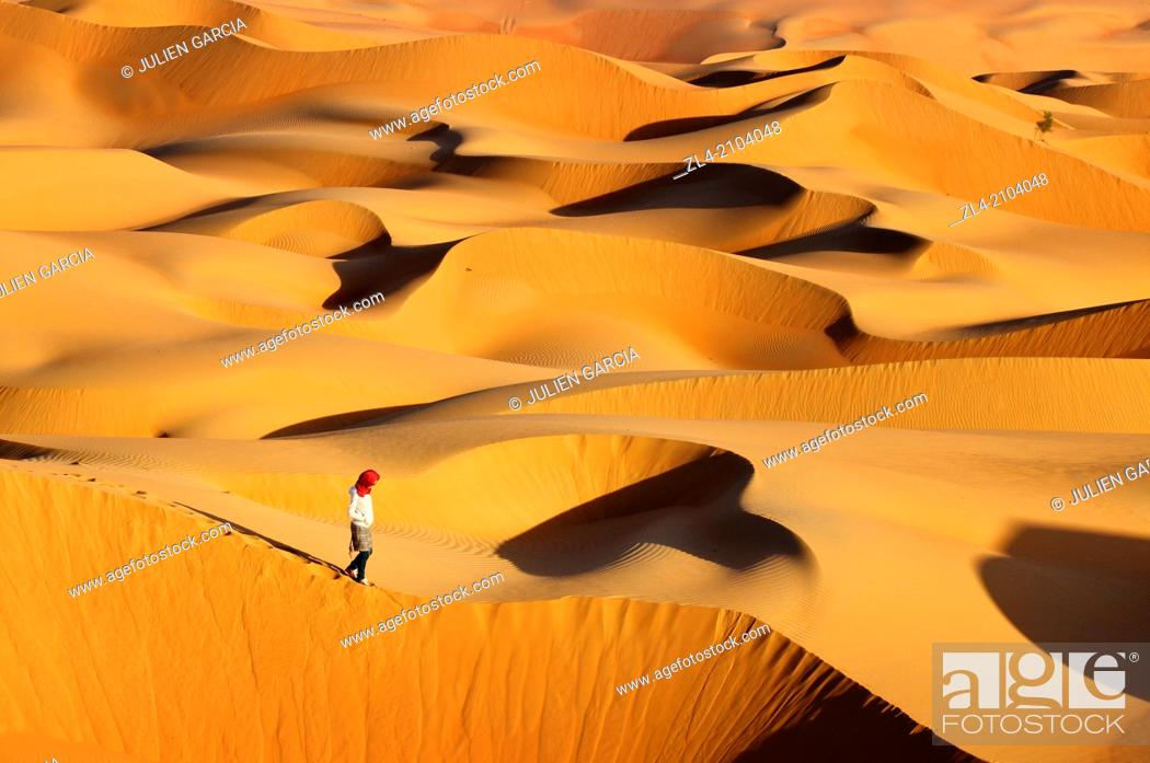 Stock Photo: Woman in the sand dunes of the empty quarter desert. United Arab Emirates, UAE, Abu Dhabi, Liwa Oasis, Moreeb Hill, Tal Mireb. Model Released.