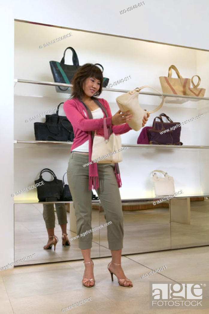 Stock Photo: Woman shopping for a handbag.