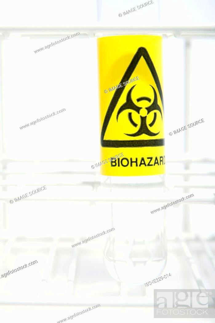 Stock Photo: Biohazard label on a test tube.