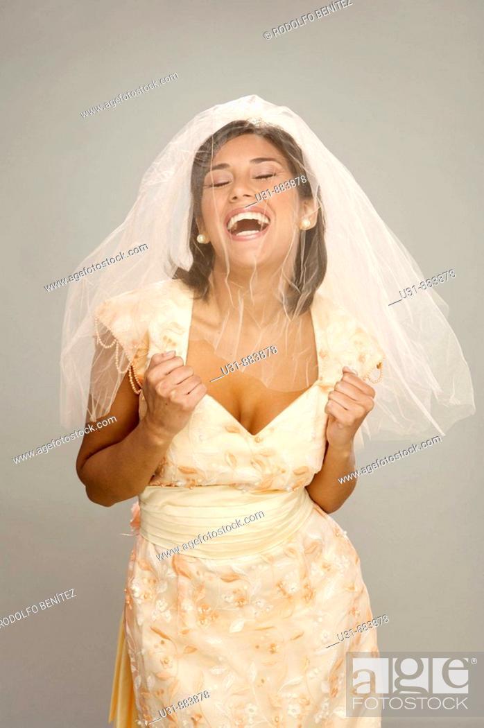 Stock Photo: Bride in her 20s celebrates in a studio setting.