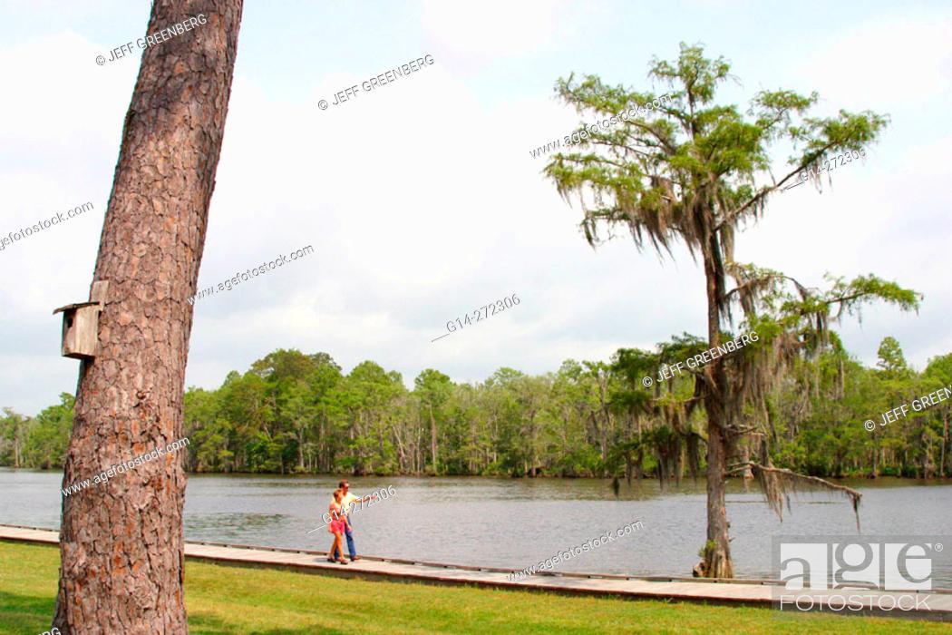 Couple on nature walk along Tchefuncte River  Fairview-Riverside