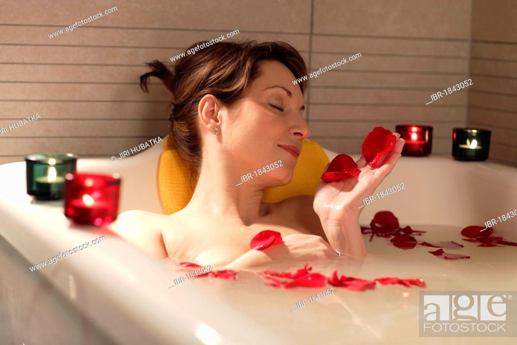 4c9997c5caf Woman, 35, relaxing in a bathtub with rose petals, Thalasso therapy ...