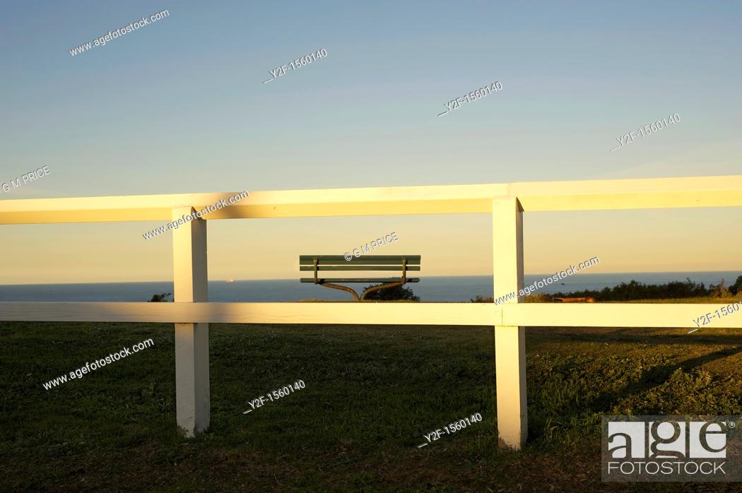 Stock Photo: white fence by the sea.
