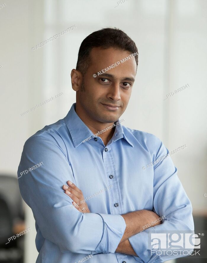 Stock Photo: Singapore, Businessman standing with folded arms.