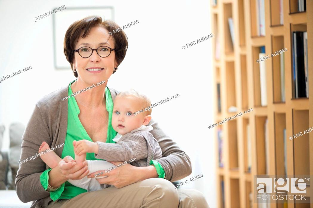 Stock Photo: Portrait of a woman with her granddaughter.