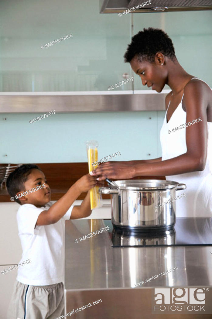 Stock Photo: Mother and son in kitchen.
