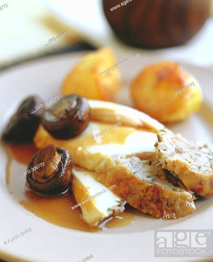 Stock Photo: Chicken breast with stuffing, mushrooms & roast potatoes.