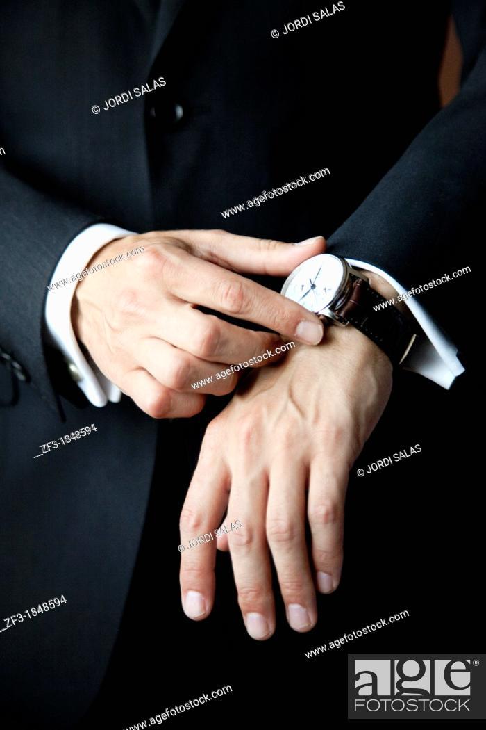 Stock Photo: Man touching his watch.