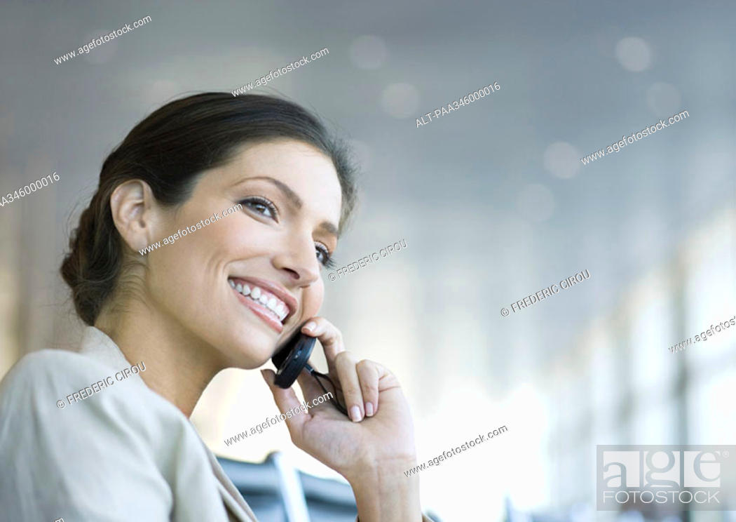 Stock Photo: Woman using cell phone, smiling.