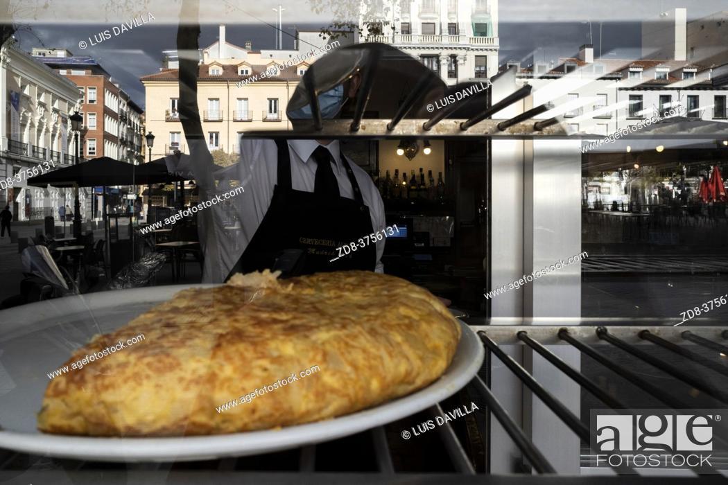Stock Photo: typical spanish tortilla de patatas in a tapas bar of santa ana square. madrid. spain.