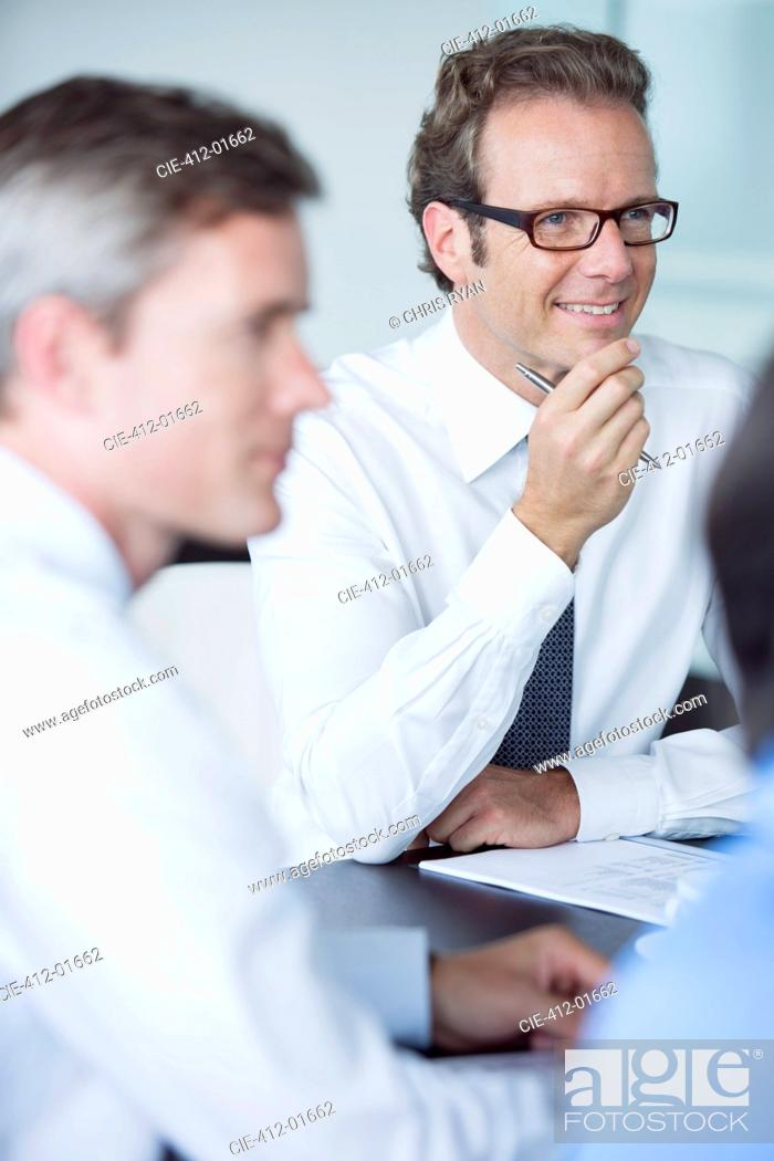 Stock Photo: Businessmen sitting in meeting.